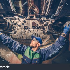 stock-photo-auto-mechanic-under-the-car-trying-to-fix-the-problem-vehicle-maintenance-concept-photo-621502637
